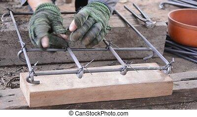 Worker working. - Worker working wire tied with rebar for...