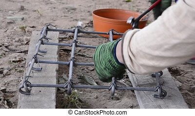 Worker working - Worker working wire tied with rebar for...