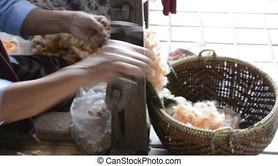 Spinning. - Old woman spinning wooden wheel prepare cotton...
