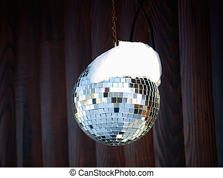 Winter discoteque - Disco ball somewhere outdoor in the ski...