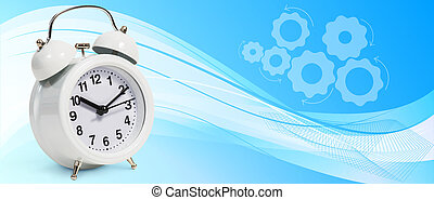 Classical alarm clock stands on the blue abstract background
