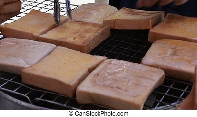 Cooking toast on the stove on the market.