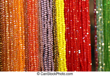 beaded necklaces for sale at the flea market - many beaded...