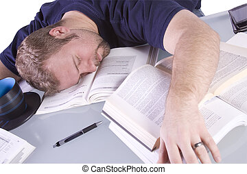 College Student Sleeping on his Desk - College Student...