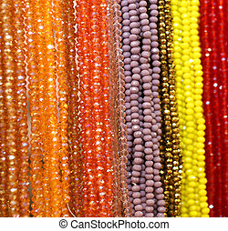 many beaded necklaces for sale at the flea market