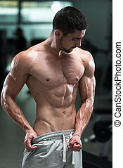 Bodybuilder Man Posing In The Gym - Awesome Bodybuilder...