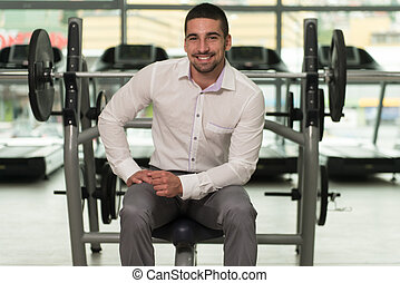 Attractive Young Businessman Resting Relaxed In Gym