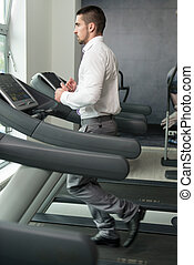 Businessman Running On Treadmill In Gym
