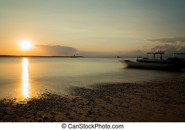 Nusa penida, Bali beach with dramatic sky and sunset -...