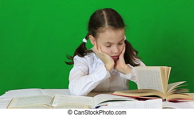 Sad girl writing, reeding Child doing homework Green screen...