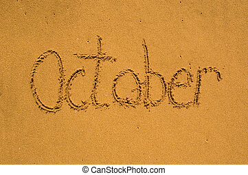 Month October in the sand