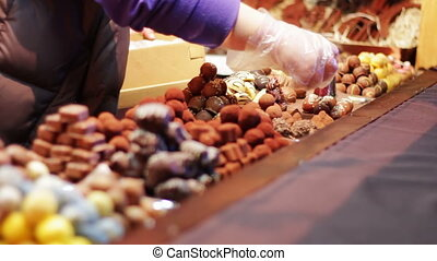 Christmas chocolates on the counter of the New Year market....