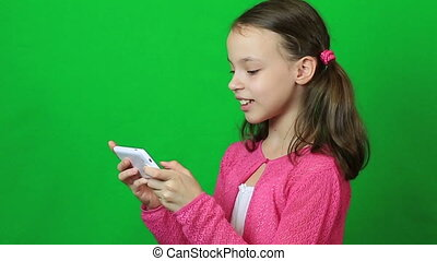 Cheerful little girl with a smartphone in hand. - Cheerful...