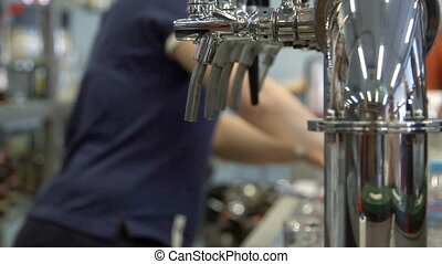 Barman pulling a pint of beer behin - Moscow, Russian...