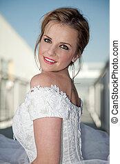 young attractive twenties caucasian bride in outdoor setting