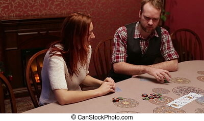 Woman and man playing poker in the casino - People playing...
