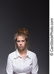 Burnout young woman - Burnout sad young woman on dark...
