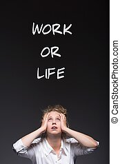 Work or life - Workaholic woman and work or life writing
