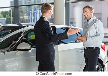 Smiling to car dealer - Customer is smiling to his car...