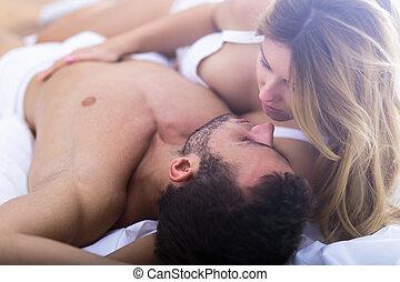 Romantic woman touching her boyfriend - Image of romantic...