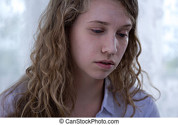 Tired teenage cyberharassment victim - Portrait of tired and...