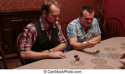 Two men playing poker in a casino