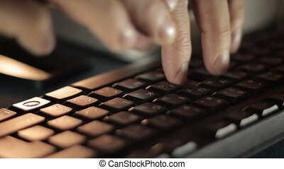 Hands typing on the remote computer keyboard 4 - Hands...