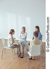 Psychotherapist giving advice - Elderly psychotherapist...