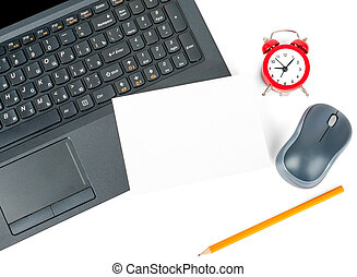 Laptop with blank card and alarm clock isolated on white...