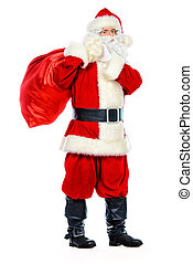 christmastime - Santa Claus stands with gifts for the...