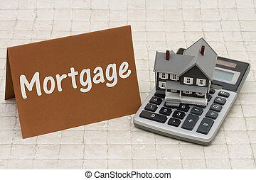 Home Mortgage, A gray house, brown card and calculator on stone background
