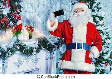 making selfie - Santa Claus makes a selfie