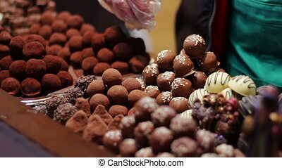 Christmas chocolates on the counter of the New Year market -...