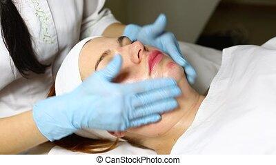 mask facial - woman passes treatment mask facial at the...