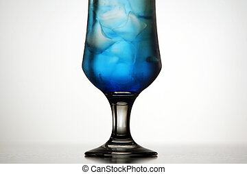 Blue cocktail - Detail of an icy blue cocktail on a light...