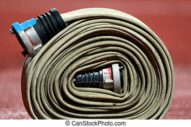 Fire fighter hose - Horizontal picture of a rolled up fire...