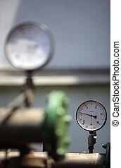 Pressure gauge against sunny background