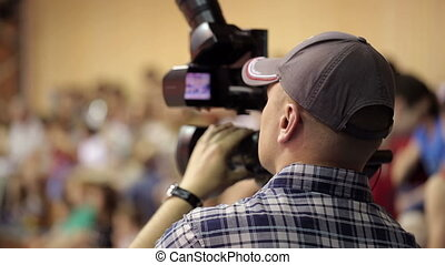 Man With Camera - videographer at a basketball game