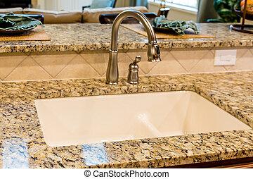 New Plumbing Fixtures on Granite Countertop