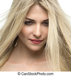 Beautiful woman with long straight blond hair.