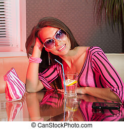 woman drinking fresh cocktail