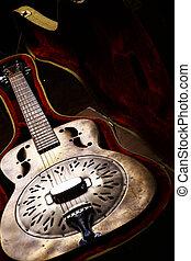 Vintage guitar in case - Color shot of a vintage guitar in a...
