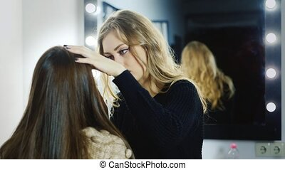 Makeup artist at work in the studio