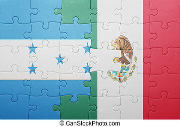 puzzle with the national flag of honduras and mexico concept...