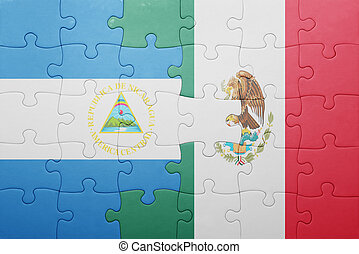 puzzle with the national flag of nicaragua and mexico...