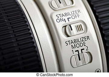 Photo lens stabilizer - Detail of the stabilizer switch on a...