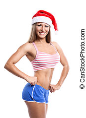 Fitness christmas woman wearing santa hat Female model...