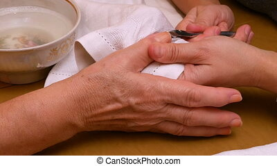 Manicure painting and polishing nails in spa salon -...