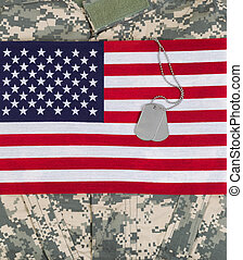 USA flag with military uniform and identification tags -...