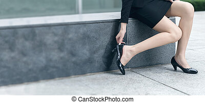 put on shoes - Business woman put on shoes after a break in...